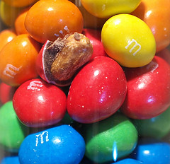 photo of blue, green, red, yellow, and orange m&m's