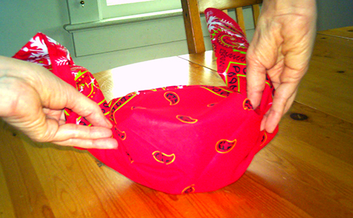 photo of grasping the bandanna ends preparatory to tying