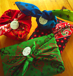 four packages wrapped in bandannas