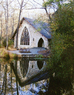 Small white chapel at the water's edge