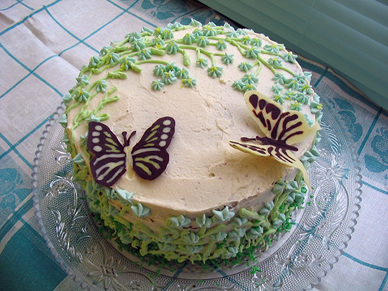 photo of cake with flowers and butterflies
