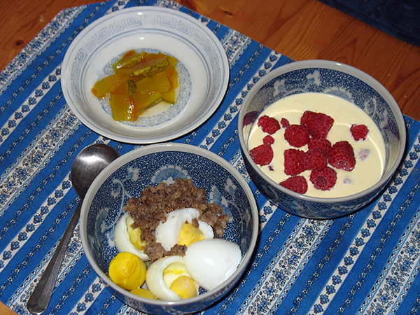 lacto-fermented watermelon pickles, berries and cream, boiled eggs and butter, ground sausage