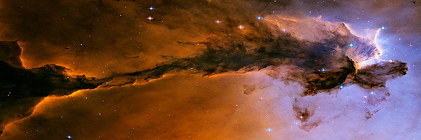 Lavender and orange nebula cloud against starfield