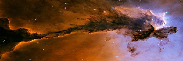 Lavender and orange nebula cloud against starfield