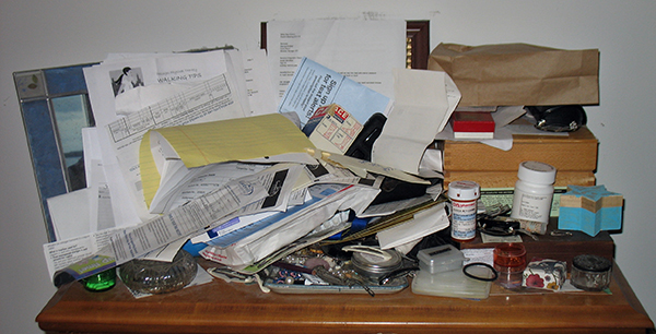 cluttered bureau surface